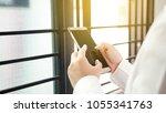 businesswoman using modern... | Shutterstock . vector #1055341763
