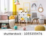 yellow pouf and grey chair in... | Shutterstock . vector #1055355476