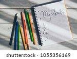my goals written in a notebook... | Shutterstock . vector #1055356169