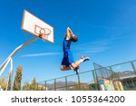 young basketball street player... | Shutterstock . vector #1055364200