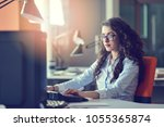 woman entrepreneur busy with... | Shutterstock . vector #1055365874