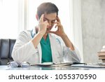 stressed young asian male...   Shutterstock . vector #1055370590