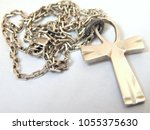 Small photo of Silver ankh on a silver chain. Jewelry. The cross Ankh is a symbol of eternal life. Ankh made of silver. Crux ansata