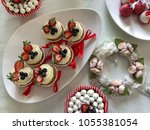 various sweet delicious... | Shutterstock . vector #1055381054