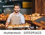 portrait of smiling shop... | Shutterstock . vector #1055391623
