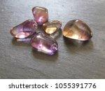 ametrine tumbled pebbles on... | Shutterstock . vector #1055391776