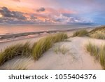sunset view from dune over... | Shutterstock . vector #1055404376