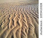 sand ripples on a beach.   Shutterstock . vector #1055413328