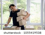 start up. young man happy after ... | Shutterstock . vector #1055419538