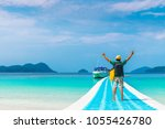 man traveler standing on sea... | Shutterstock . vector #1055426780