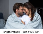young man embracing his...   Shutterstock . vector #1055427434