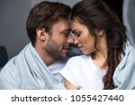 young attractive couple hugging ... | Shutterstock . vector #1055427440