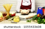 male hands work with kneaded...   Shutterstock . vector #1055433608