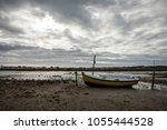 dry boat on la chnou  swamp in... | Shutterstock . vector #1055444528