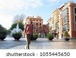 teenager girl walking in... | Shutterstock . vector #1055445650