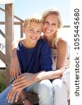 portrait of mother and son on... | Shutterstock . vector #1055445680