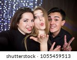 three young men and two women ... | Shutterstock . vector #1055459513