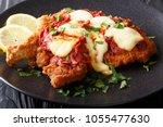 milanesa a la napolitana beef... | Shutterstock . vector #1055477630