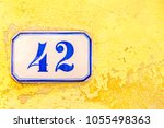 numbered tile on a wall | Shutterstock . vector #1055498363
