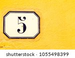 numbered tile on a wall   Shutterstock . vector #1055498399