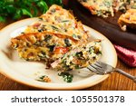 portion of frittata made of... | Shutterstock . vector #1055501378