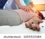 Small photo of First Aid - Doctors are helping young women with CPR in cases of heart failure due to overdose.