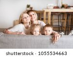 happy family  mother three... | Shutterstock . vector #1055534663