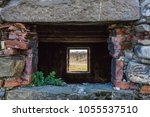 old stone wall of abandoned... | Shutterstock . vector #1055537510