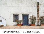 typical mediterranean blue door ... | Shutterstock . vector #1055542103