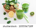 glass of green smoothie on... | Shutterstock . vector #1055567189