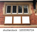 Small photo of three display advert boxes On a English village hall building blank ad space