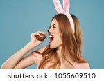 woman with chocolate egg on a... | Shutterstock . vector #1055609510