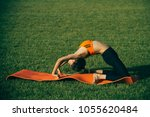 Small photo of Active woman training on green grass, activity concept. Activity outdoor, energy, fitness, sport.