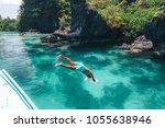 man jumping into clear sea... | Shutterstock . vector #1055638946