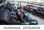 asian boy sitting on go kart... | Shutterstock . vector #1055646536