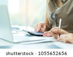 financial team analyse finance... | Shutterstock . vector #1055652656