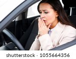 closeup shot of stressed young...   Shutterstock . vector #1055664356