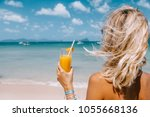 back view of woman relaxing on... | Shutterstock . vector #1055668136