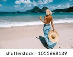 back view of woman relaxing on... | Shutterstock . vector #1055668139
