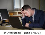 a young  manager working on a... | Shutterstock . vector #1055675714