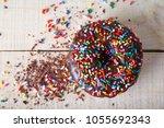 overhead studio shot of a donut ... | Shutterstock . vector #1055692343