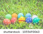 painted easter eggs put on the... | Shutterstock . vector #1055693063