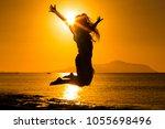 silhouette of happy girl... | Shutterstock . vector #1055698496