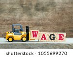 yellow forklift hold block w to ... | Shutterstock . vector #1055699270