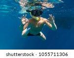 boy in swimming mask dive in... | Shutterstock . vector #1055711306