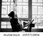 black and white woman smoking... | Shutterstock . vector #1055713856