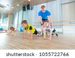children at physical education... | Shutterstock . vector #1055722766