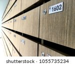 natural wood aged mailboxes  or ... | Shutterstock . vector #1055735234