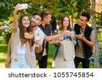 group photo of friends  selfie... | Shutterstock . vector #1055745854