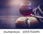 close up of bread and a cup of... | Shutterstock . vector #1055752694